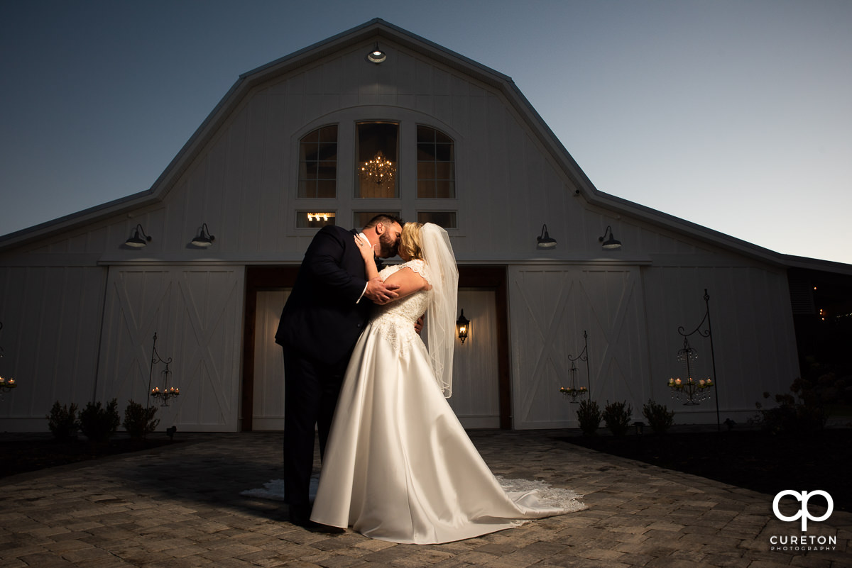 Bride and groom kissing outside of Heyward Manor in Iva,SC.