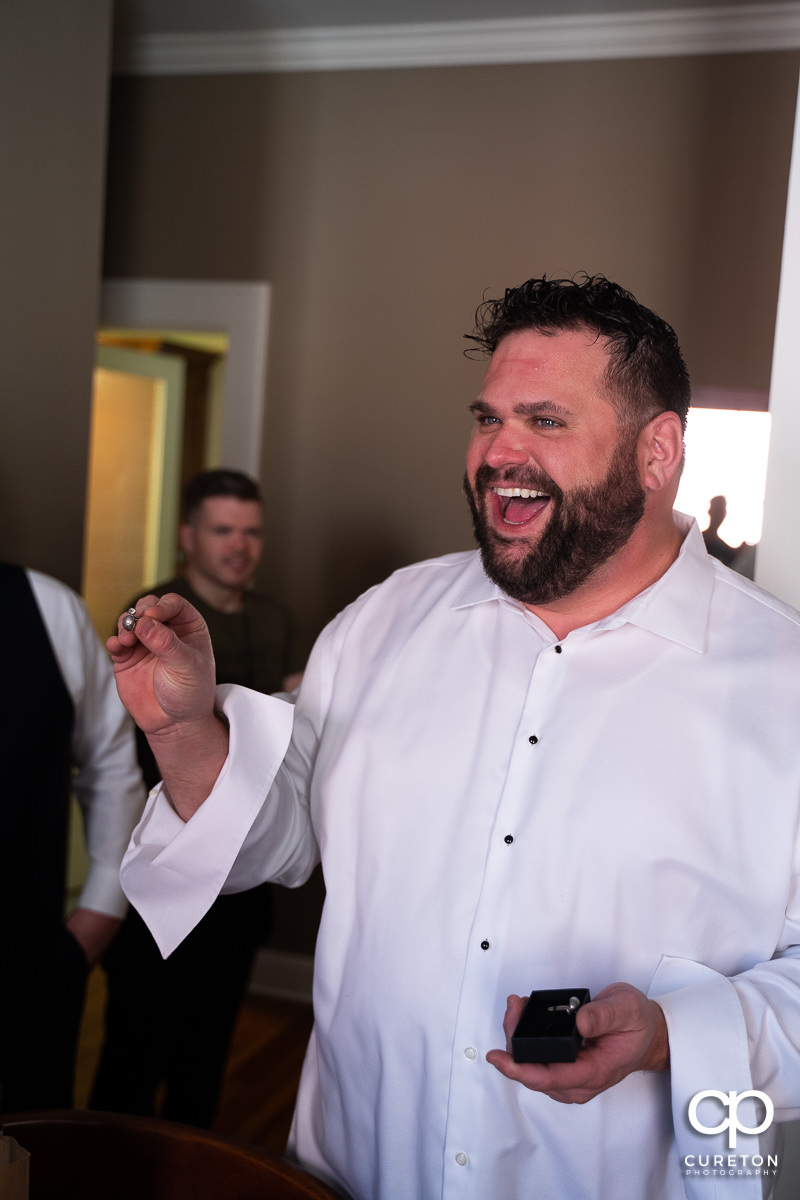 Groom excited at a gift.