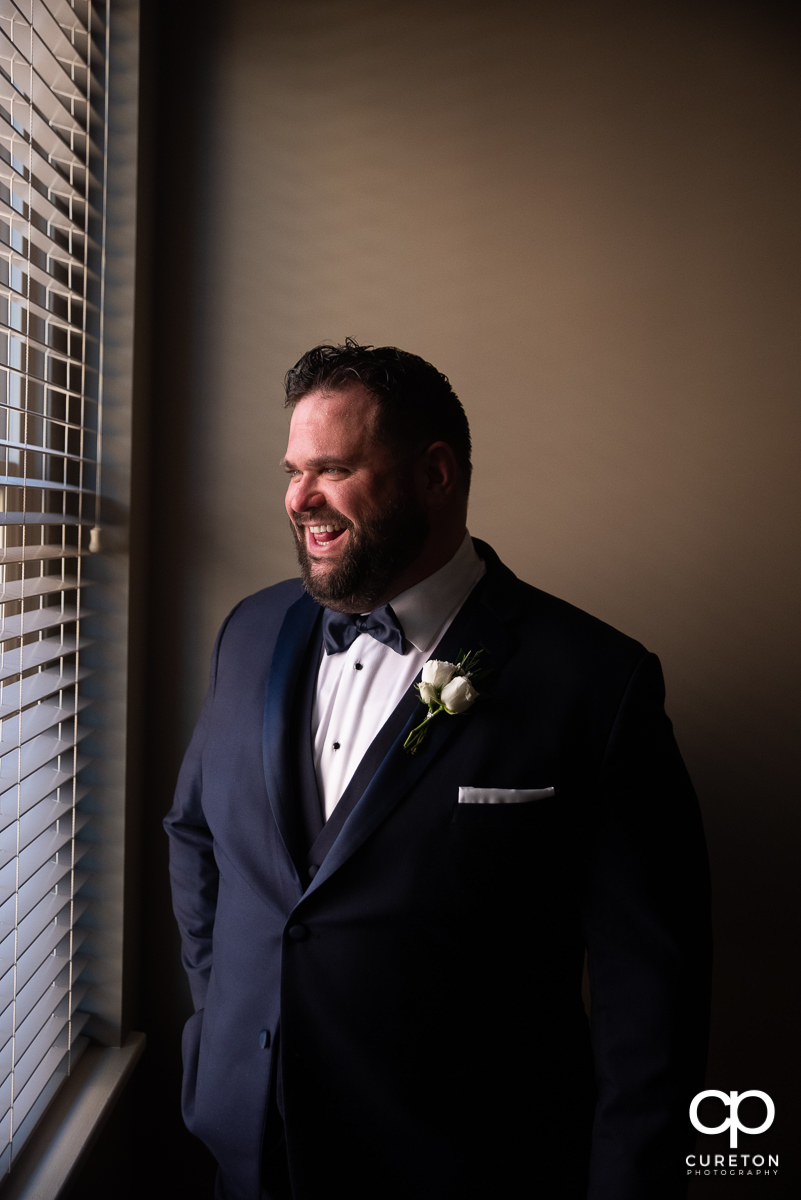 Groom laughing out the window.