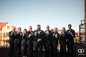 Groom and groomsmen on a rooftop.