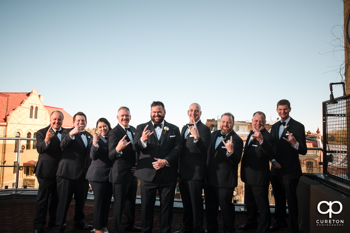 Groom and groomsmen on a rooftop.