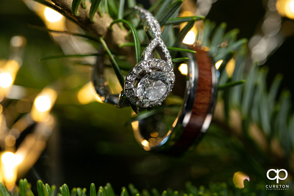 Wedding rings on a Christmas tree.