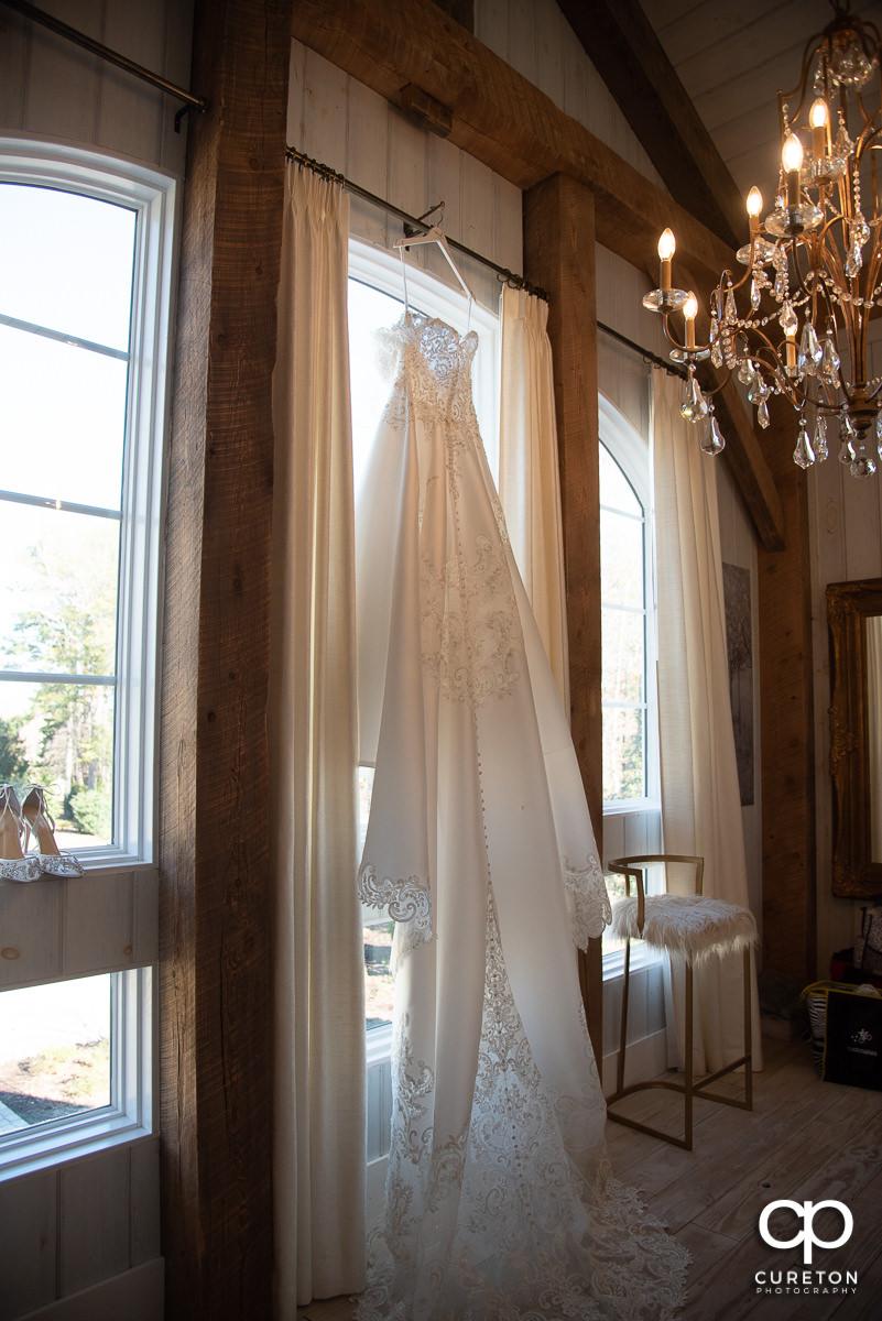 Bride's dress in window.