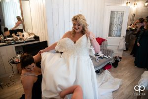 Bride getting into her dress.
