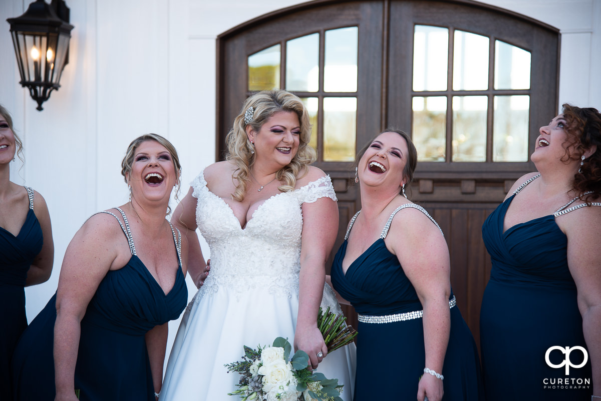 Bride laughing with friends.