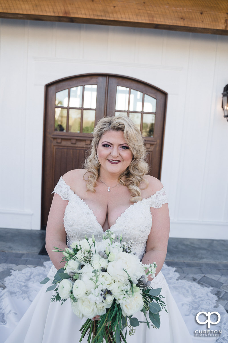 Bride in front of Heyward Manor.
