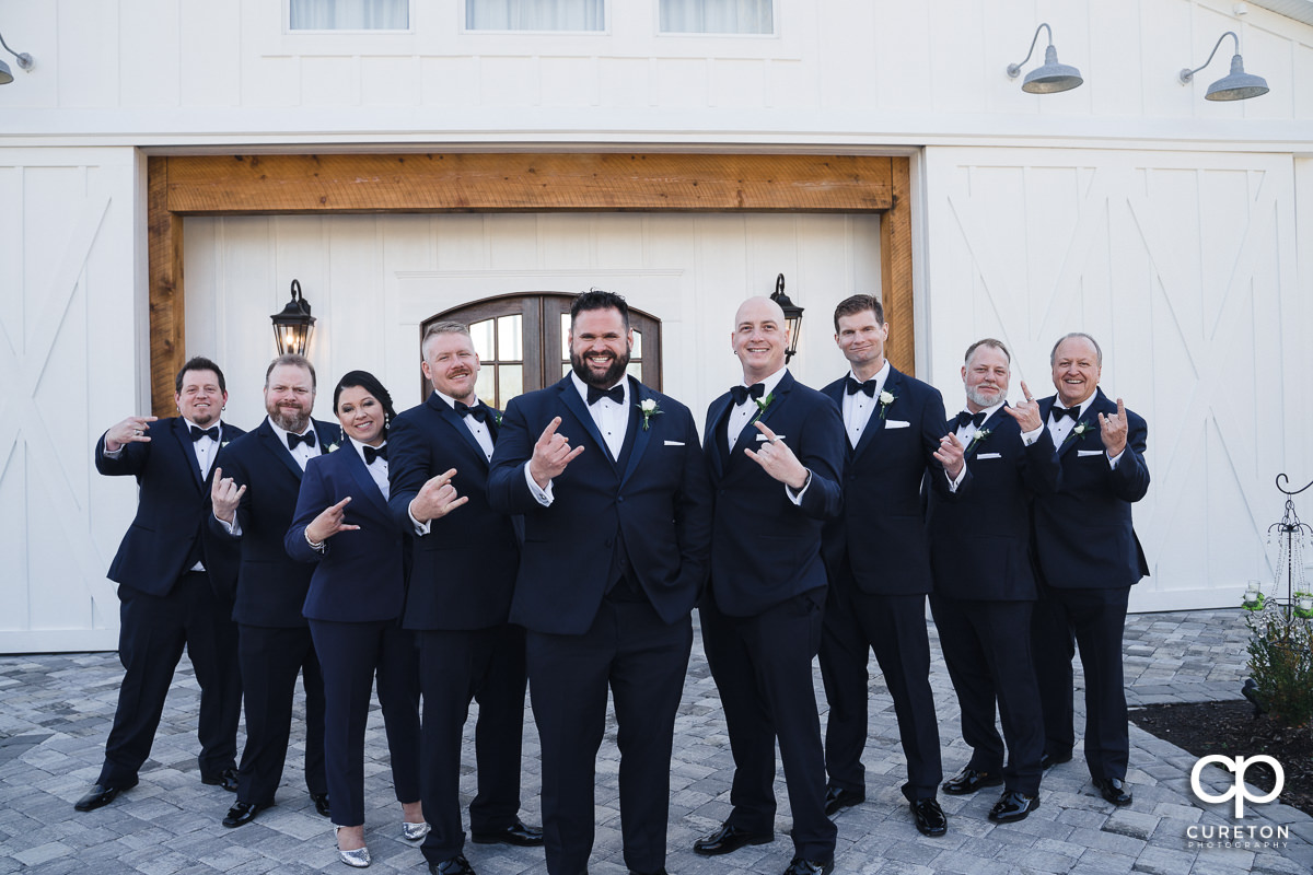 Groom and groomsmen posing.