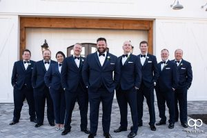 Groom and groomsmen in a v formation.