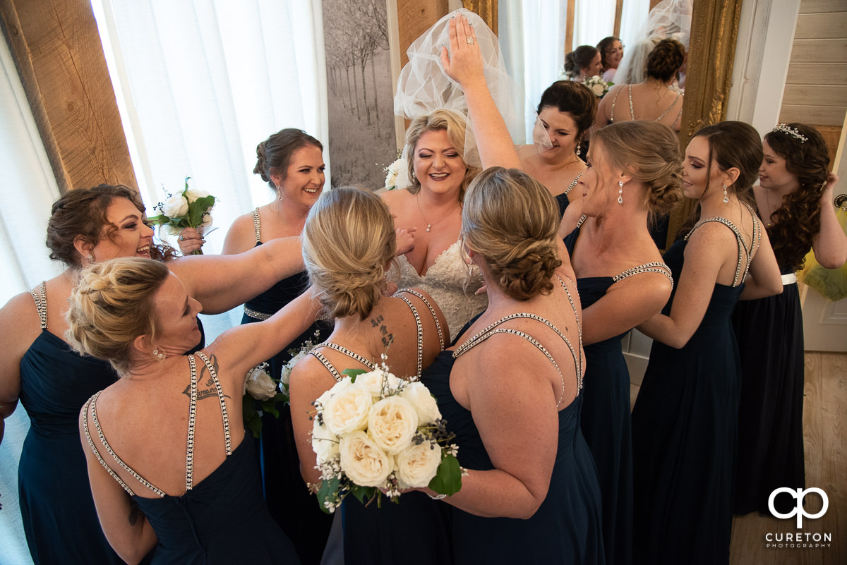 Bridesmaids surrounding the bride.