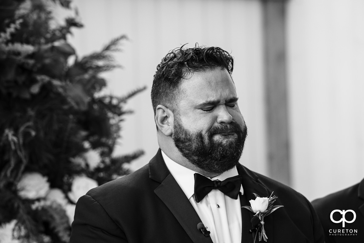 Groom at the alter.