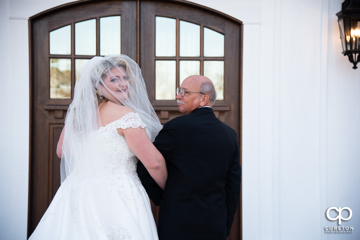 Bride and her father outside her venue.