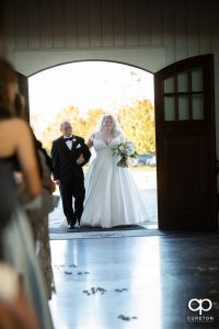 Bride and her dad making an entrance.