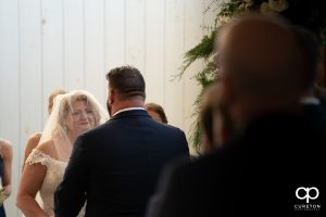 Bride crying during her vows.