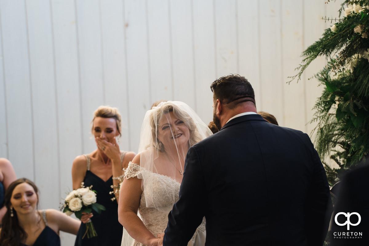 Bride looking at her groom.