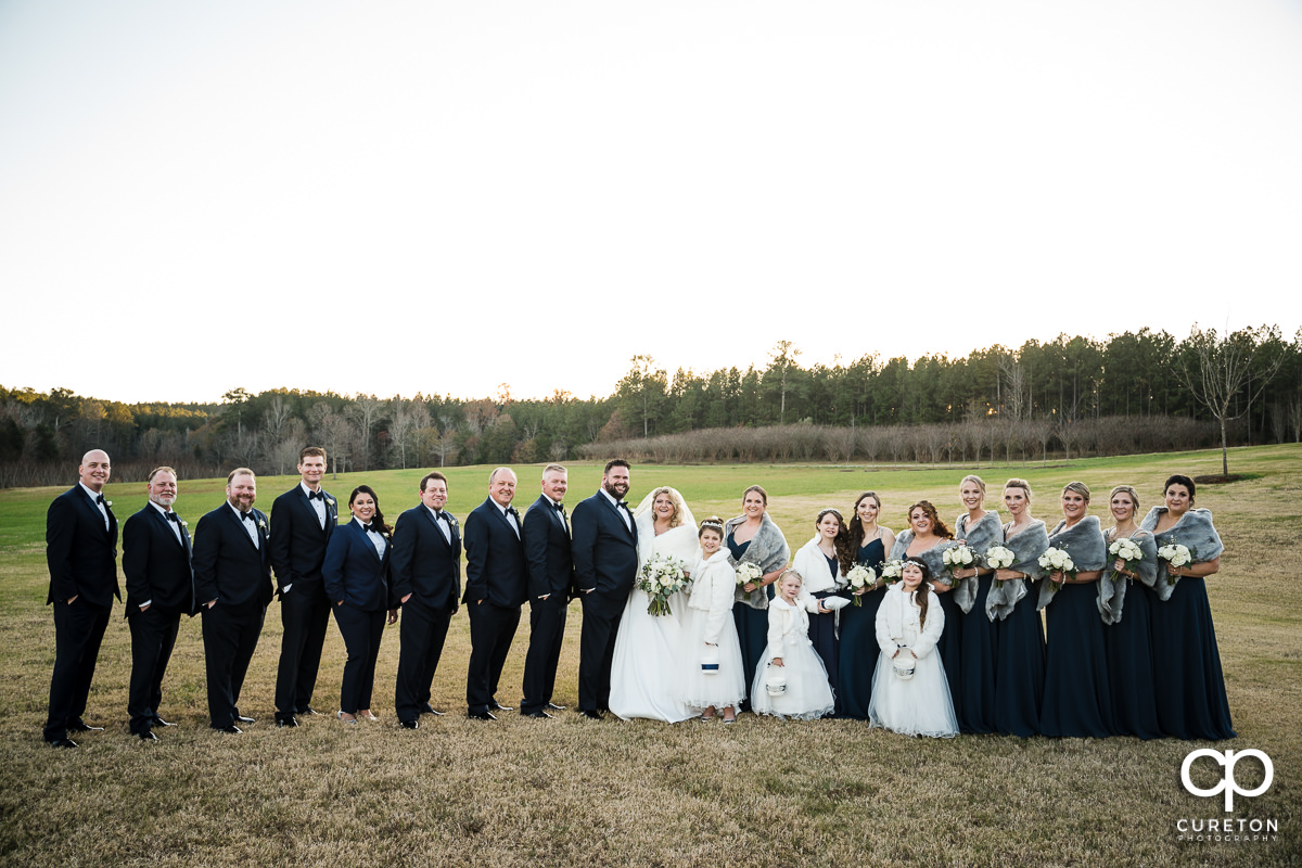 Wedding party in a field.