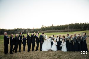 Bridal party cheering on the bride and groom.