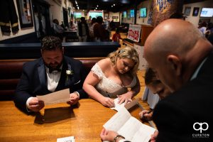 Bride and groom in a booth at Wild Wings.