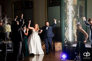 Bride and groom making an entrance into the wedding reception with spark fountains at Bleckley Station in Anderson,SC.
