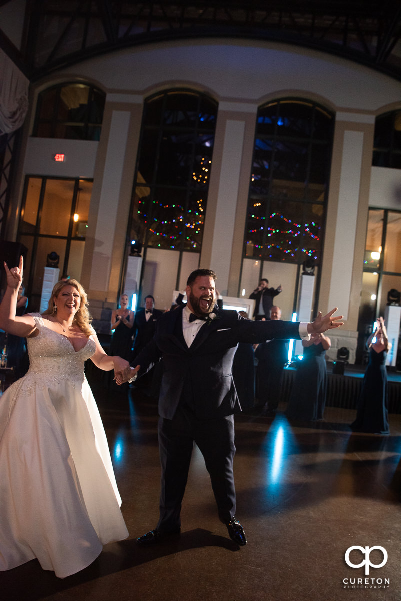 Bride and groom dancing into the reception.