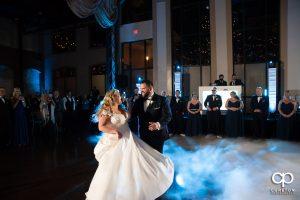 Bride and groom dancing on a cloud.