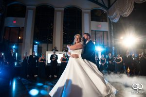 Groom and bride having a first dance.