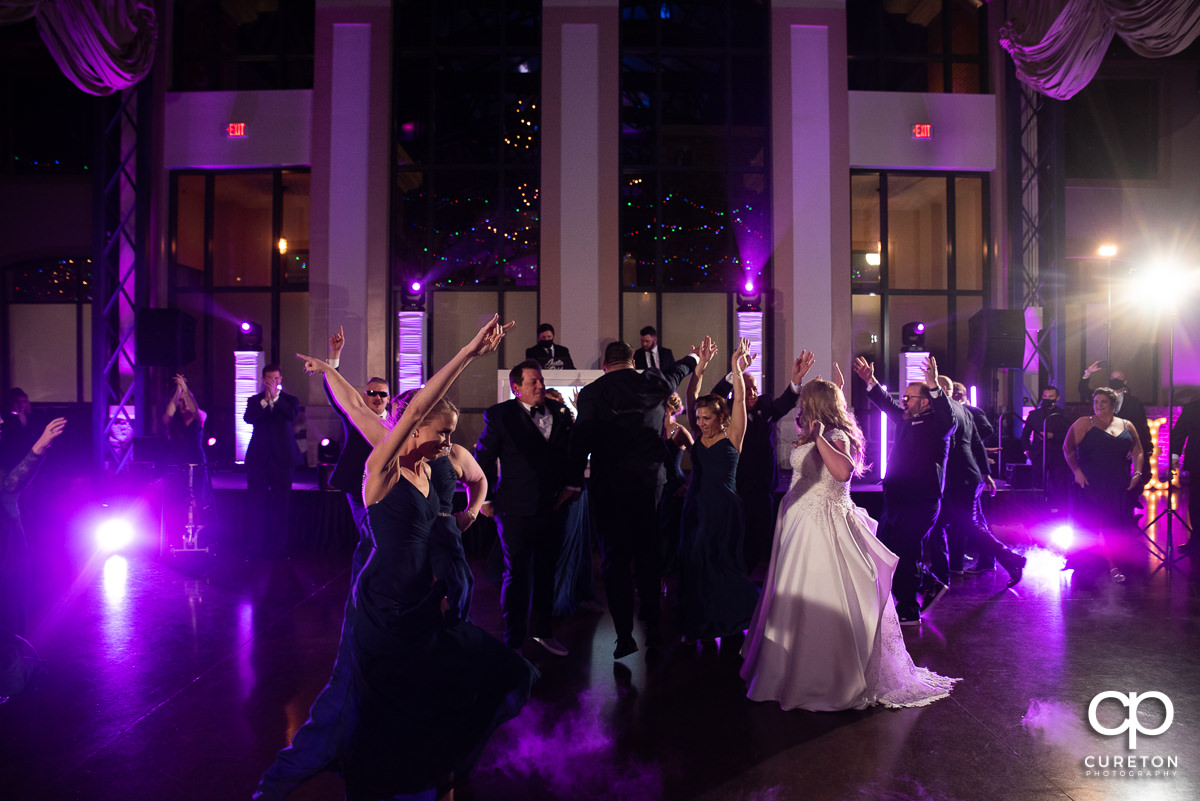 Wedding party doing a choreographed dance.