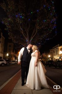 Bride and groom kissing on the street in downtown Anderson,SC.