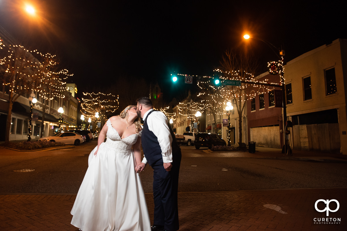 Bride and groom crossing the street in downtown Anderson,SC.