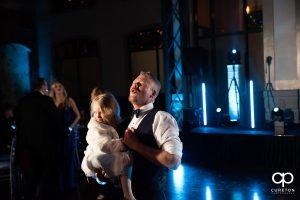 Groomsmen dancing with his daughter.