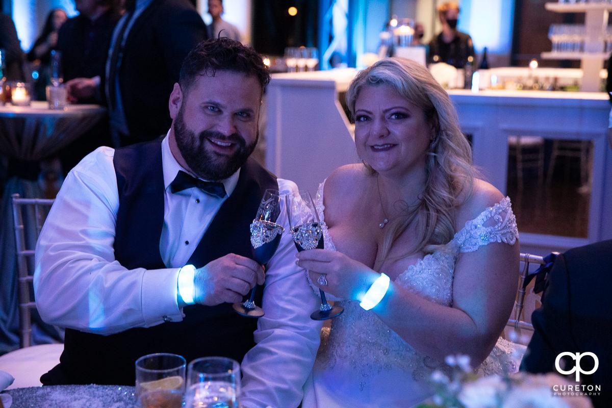 Bride and groom toasting.