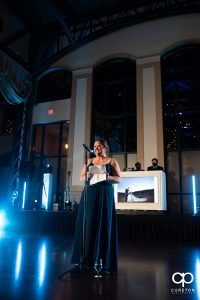 Maid of honor giving a speech.