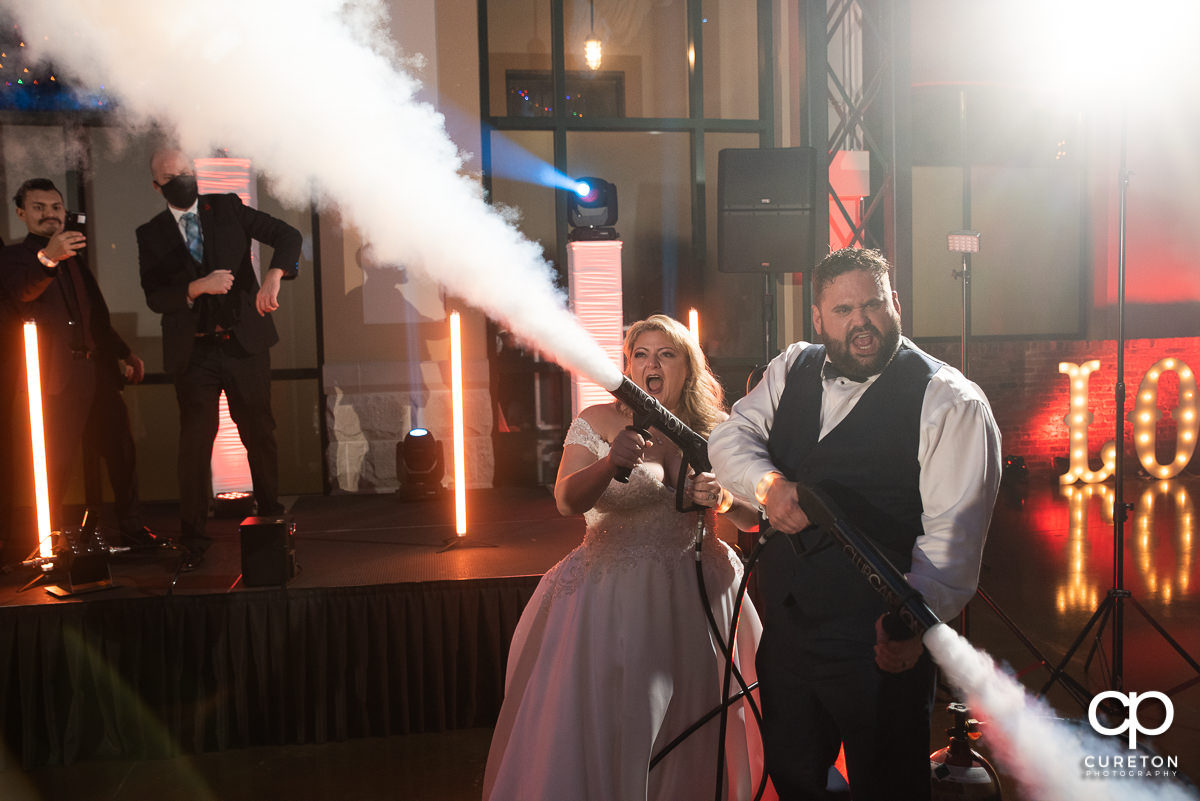Bride and groom using club cannons.
