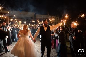 Bride and groom having a grand exit with sparklers.