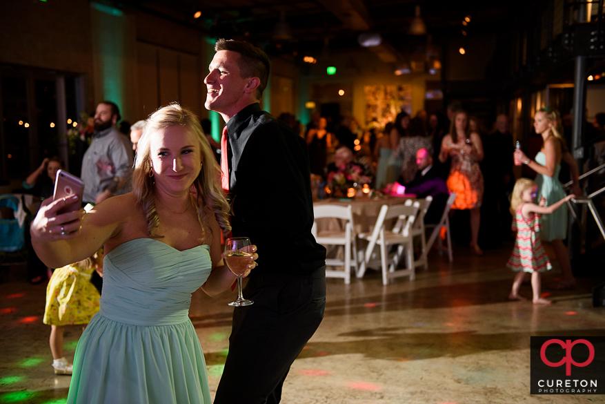 Wedding guests taking a selfie.
