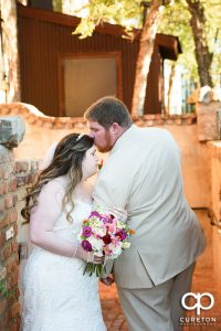 Bride and groom outside in the courtyard before their wedding reception at The Old Cigar Warehouse.