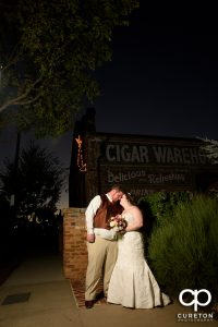 Bride and groom at dusk during their wedding reception at The Old Cigar Warehouse.