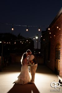 Bride and groom on the deck of The Old Cigar Warehouse in Greenville,SC.