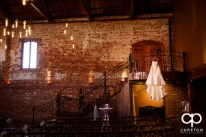 Bride's dress hanging in The Old Cigar Warehouse.