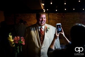 Groom getting his boutonniere pinned.