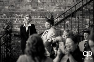 Groom sees his bride for the first time walking down the aisle.