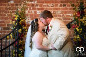 Bride and groom first kiss.