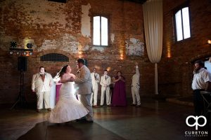 Bride and groom first dance at Old Cigar Warehouse.