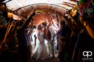 Epic glow stick wedding leave at The Old Cigar Warehouse in Greenville,SC.