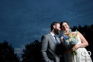 Bride and groom at sunset during their wedding reception at Old Cigar Warehouse.