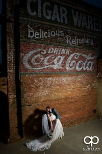 Bride and Groom dancing outside during their wedding reception at Old Cigar Warehouse.