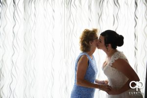 Bride and her mother sharing a moment before the wedding.