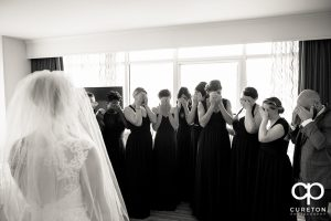 Bridesmaids prepared to see the bride for the first time.