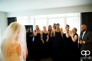 Bride reveal to the bridesmaids.