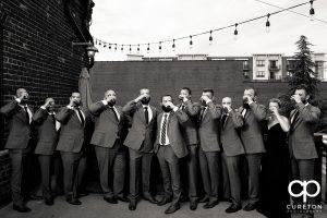 Groom and groomsmen having a pre-wedding drink.
