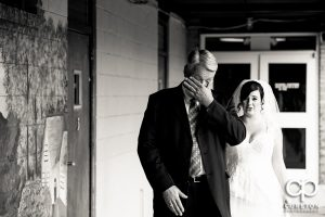 Brides father sees his daughter for the first time in the dress.